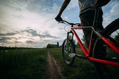 Tourist resting with his bicycle enjoying sunset Royalty Free Stock Photography