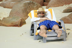 Tourist resting on a lounger. Sandy beach at the shores of India Stock Photo