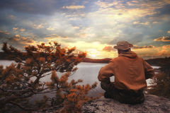 Tourist resting in mountains at sunset. Tourist resting in the mountains at sunset Stock Photos