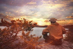 Tourist resting in mountains at sunset Royalty Free Stock Images