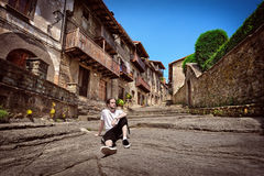 Tourist resting on an old street Stock Image