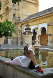 Tourist resting, Patio de los Naranjos at Mosque in Cordoba, Spain Royalty Free Stock Photography