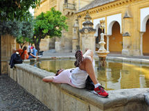 Tourist resting, Patio de los Naranjos at Mosque in Cordoba, Spain Royalty Free Stock Photos