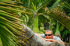 Tourist resting in the tropical garden. Tourist resting in the tropical botanical garden in Yunnan, China stock photography