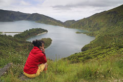 Tourist resting in Volcanic Lake lagoa do fogo, Sao Miguel Azore Stock Images
