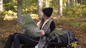 Tourist rests with map in forest stock footage