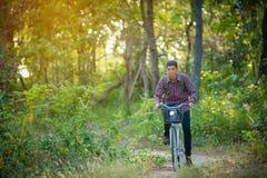 Tourist riding bicycle Royalty Free Stock Photo
