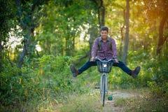 Tourist riding bicycle Royalty Free Stock Image
