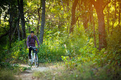 Tourist riding bicycle Stock Photo