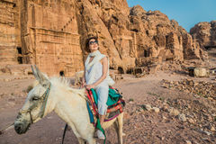 Tourist riding donkey  in nabatean city of  petra jordan Royalty Free Stock Photos