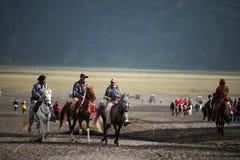 Tourist riding horse to Bromo Stock Photo