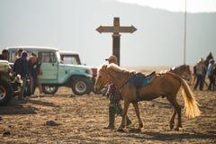 Tourist riding horse to Bromo Royalty Free Stock Photo
