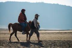 Tourist riding horse walking Royalty Free Stock Photo