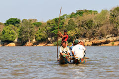 Tourist river excursion. Tourists take an excursion on the Manambolo river with traditional boats in Belo Tsiribihina, Madagascar, on September 15, 2013 Royalty Free Stock Image