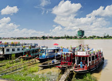 Tourist river tour boats in riverside phnom penh city cambodia Royalty Free Stock Photography