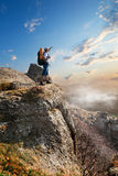 Tourist on rock Royalty Free Stock Photo