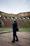 Tourist in Roman Amphitheater Royalty Free Stock Photo