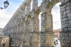Tourist, Roman aqueduct of segovia. architectural monument declared patrimony of humanity and international interest by UNESCO. S. Pain royalty free stock image