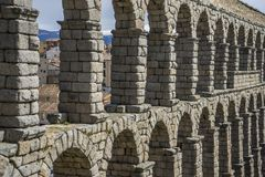 Tourist, Roman aqueduct of segovia. architectural monument declared patrimony of humanity and international interest by UNESCO royalty free stock photography