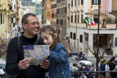 Tourist in rome with city map Royalty Free Stock Photo