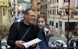 Tourist in rome with city map Royalty Free Stock Photos