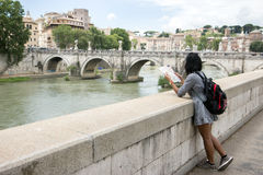 Tourist in Rome. Tourist standing on riverside in Rome Stock Photo