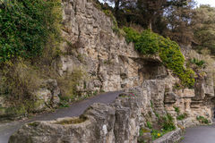 Tourist route, powerful rocks and vegetation, rock cave, interes Stock Photography