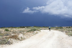 Tourist on a rural road in Koufonissi island Royalty Free Stock Photos