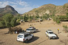 Tourist's cars parked at a small village, Adwa, Ethiopia. Royalty Free Stock Photography