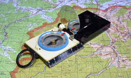 Tourist's compass at map Stock Images