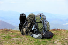 Tourist's equipment on meadow in mountains Stock Photography