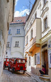 Tourist's train in old historical aisle alley street in Bratislava. Bratislava is the capital of Slovakia on Danube River. Royalty Free Stock Photos