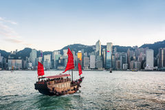 Tourist sailboat crosses Victoria harbor. Hong Kong Royalty Free Stock Photos