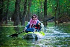 Tourist sailing on kayak Stock Images