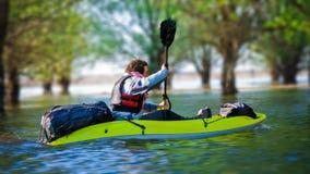 Tourist sailing on kayak stock photos