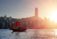 Tourist sailing ship crosses Victoria harbor, Hong Kong Royalty Free Stock Images