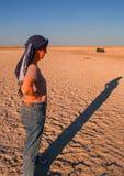 Tourist on salt pans of Botswana Stock Photography