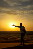 Tourist on a sand dunes at sunset Stock Photography