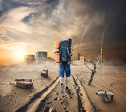 Tourist in a sandy desert Royalty Free Stock Photography