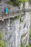 Tourist at scary footpath around cliffs in Tianmen mountain, China Royalty Free Stock Photos