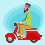 Tourist on a scooter going down the road. Bearded fashionable tourist riding a scooter on the road royalty free stock photo