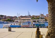 Tourist seats on the Trogir sea promenade Stock Image