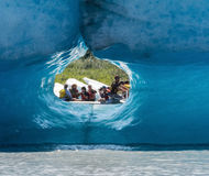 Tourist seen through ice tunnel Royalty Free Stock Image