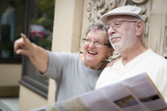 Tourist Senior Couple Looking at Brochure Map Royalty Free Stock Photos