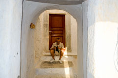 A tourist set his camera on the stairs. Of a typical street of the town of Pyrgos royalty free stock photos