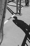 Tourist shadow on bridge Royalty Free Stock Photo