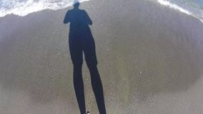 Tourist shadow on the sand stock footage