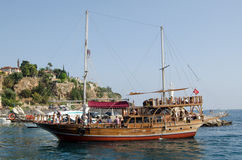 Tourist Ship, Antalya, Turkey. ANTALYA, TURKEY - AUGUST 18, 2014:  A ship with decorative masts and other fittings taking tourists around the coastline of Turkey Royalty Free Stock Photography