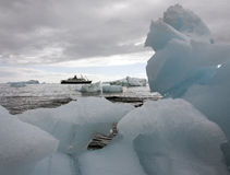 Tourist ship in Antarctica. A tourist Ship and sea ice in Antarctica royalty free stock photos