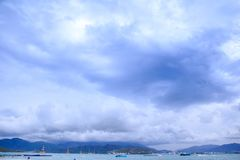 Tourist Ship on Sea Distant Resort City Sky Clouds Royalty Free Stock Image